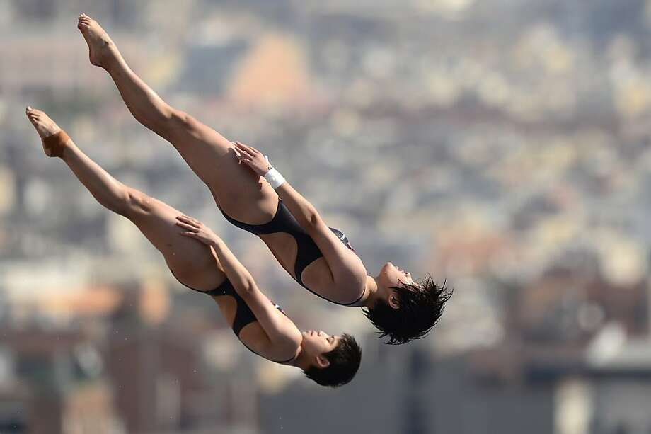 China's Liu Huixia and Chen Ruolin compete in the women's 10-metre synchro platform preliminary diving event. Photo: Javier Soriano, AFP/Getty Images