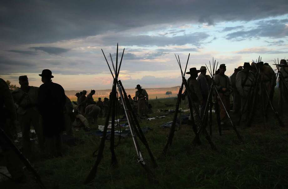 Civil War re-enactors, silhouetted against the horizon, mill around their camp. Recently, Americans observed the 150th anniversary of the battle of Gettysburg. Equally important for this nation was the defeat of the French in Mexico in the 1860s. Photo: John Moore, Getty Images / 2013 Getty Images