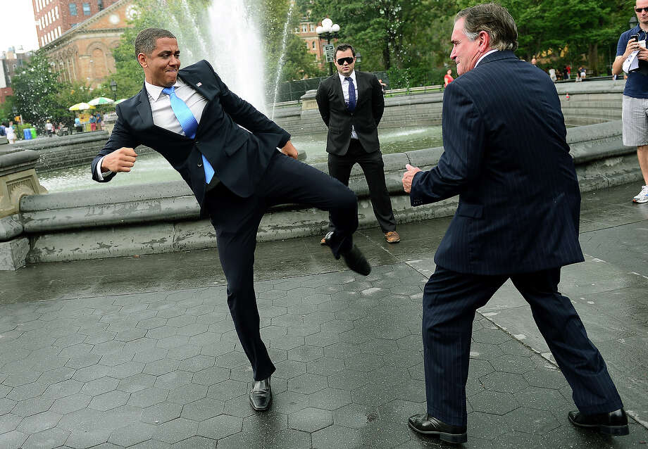 Fake Obama kicks fake Romney. Photo: EMMANUEL DUNAND, AFP/Getty Images / 2012 AFP