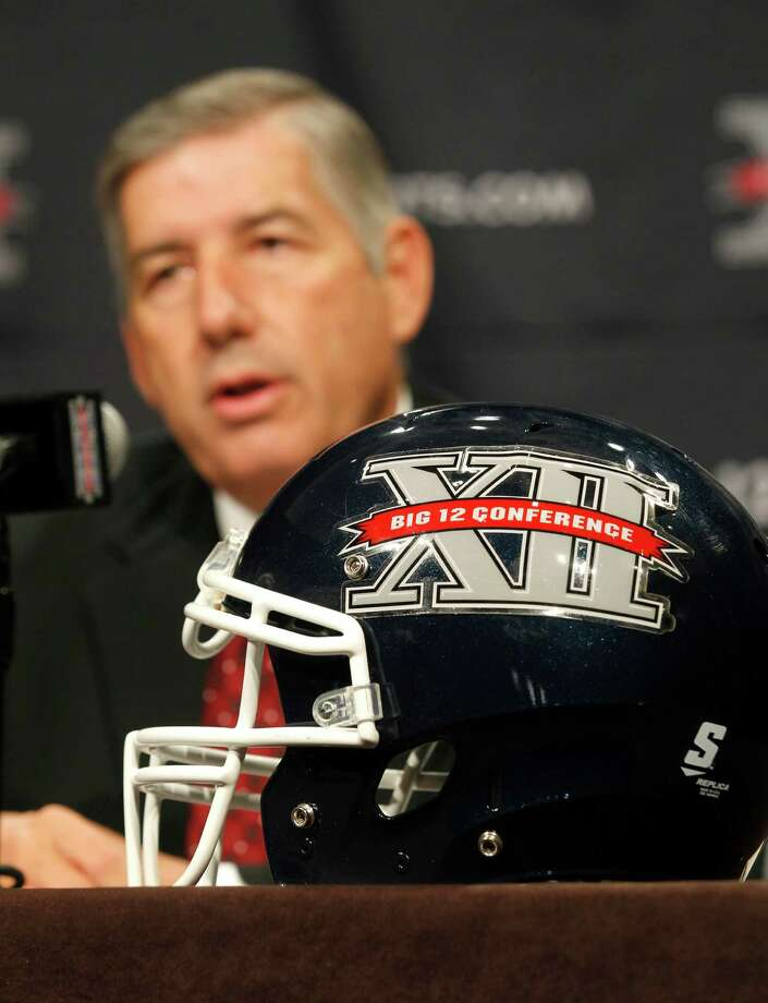 Big 12 Conference Commissioner Bob Bowlsby addresses the media at the beginning of the Big 12 Conference Football Media Days, Monday, July 22, 2013 in Dallas.  (AP Photo/Tim Sharp) Photo: TIM SHARP, Associated Press / FR62992 AP