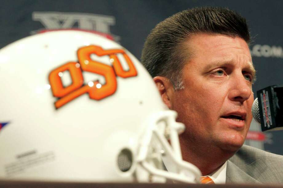 Oklahoma State University football coach Mike Gundy addresses the media at the beginning of the Big 12 Conference Football Media Days Monday, July 22, 2013 in Dallas.  (AP Photo/Tim Sharp) Photo: TIM SHARP, Associated Press / FR62992 AP