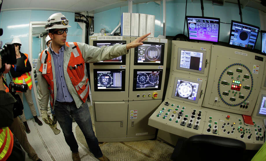"Juan Garnero, a construction manager with Seattle Tunnel Partners, gives a tour of the control room of ""Bertha,"" the massive tunnel-boring machine that is expected to spend the next 14 months drilling a two-mile tunnel to replace the 60-year-old Alaskan Way Viaduct. Photo: Ted S. Warren, AP / AP"