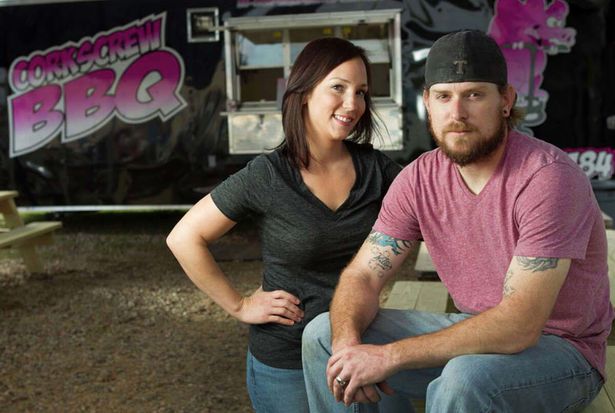 Nichole and Will Buckman pose for a portrait outside Corkscrew BBQ.