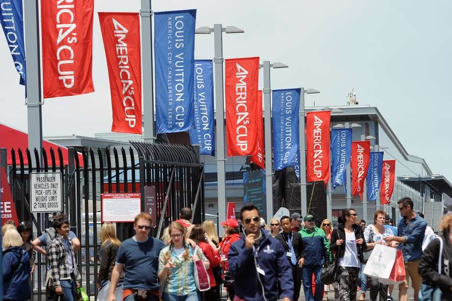 Fans stream out of the America's Cup Pavilion on Pier 27 following the Louis Vuitton Cup Race.