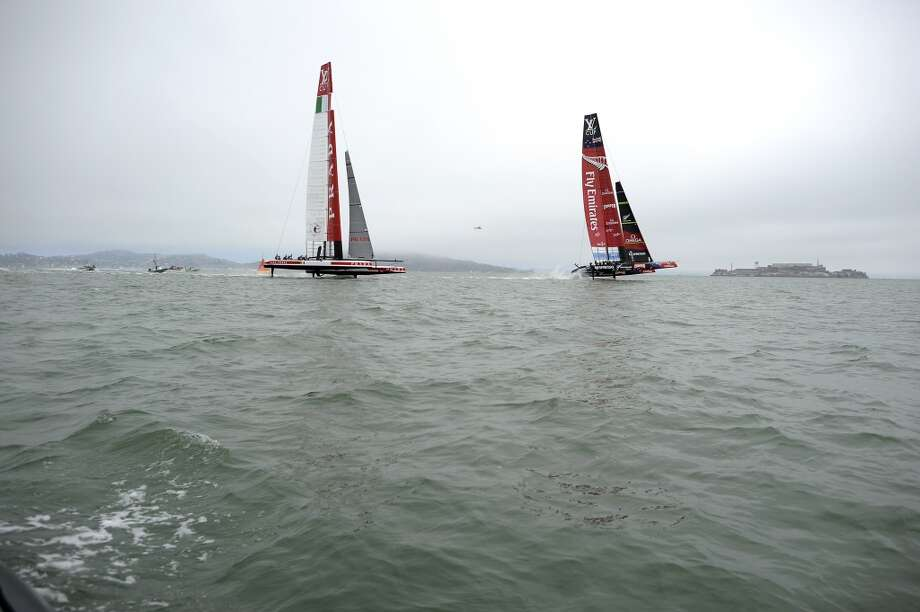 Team Luna Rossa Challenge (L) races against Emirates Team New Zealand during The Louis Vuitton Cup Race.