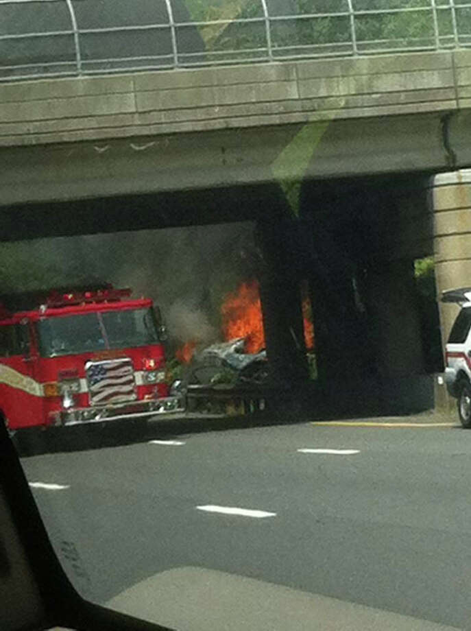 Retired Milford police sargeant Joseph Della Monica Jr. took this cell phone photo of a burned out SUV on the Garden State Parkway. Della Monica was credited with pulling the driver from the vehicle before it exploded. Photo: Contributed Photo / Connecticut Post Contributed
