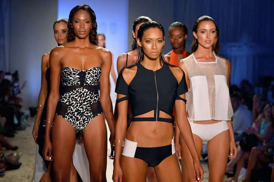 MIAMI, FL - JULY 19:  Models walk the runway at the Suboo show during Mercedes-Benz Fashion Week Swim 2014 at Oasis at the Raleigh on July 19, 2013 in Miami, Florida. Photo: Frazer Harrison, Getty Images For Mercedes-Benz Fashion Week Swim 2014 / 2013 Getty Images