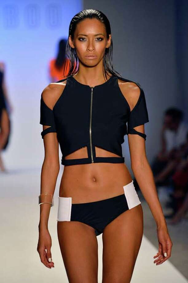 MIAMI, FL - JULY 19:  A model walks the runway at the Suboo show during Mercedes-Benz Fashion Week Swim 2014 at Oasis at the Raleigh on July 19, 2013 in Miami, Florida. Photo: Frazer Harrison, Getty Images For Mercedes-Benz Fashion Week Swim 2014 / 2013 Getty Images