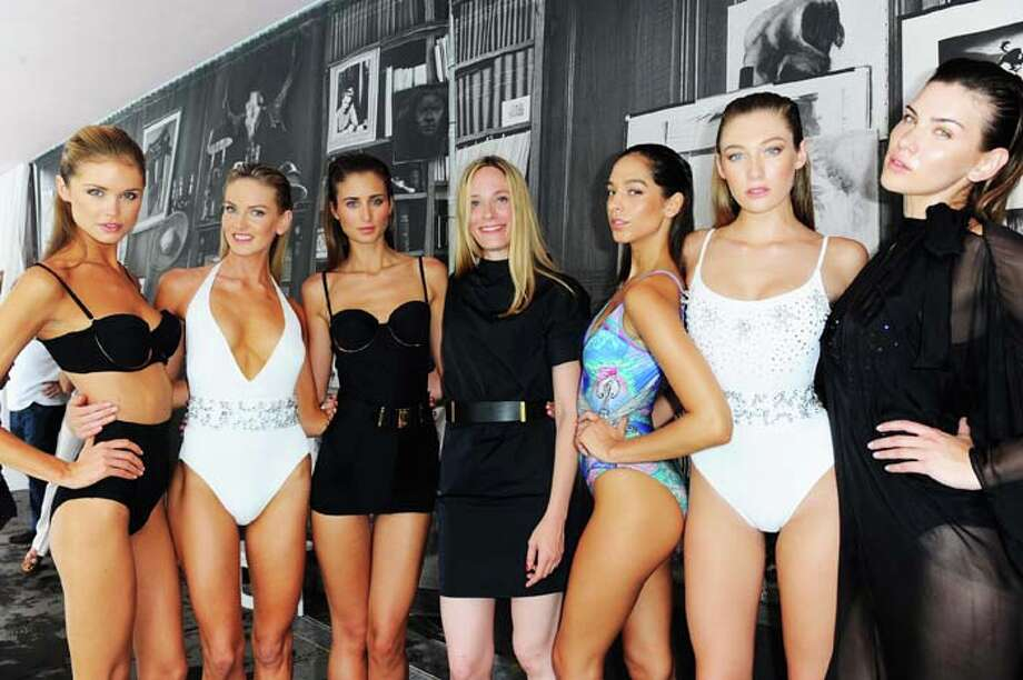 MIAMI, FL - JULY 21:  Creative Director Molly Grad poses with models at the Gottex show during Mercedes-Benz Fashion Week Swim 2014 at the SLS Hotel on July 21, 2013 in Miami, Florida. Photo: Serg Alexander, Getty Images For Mercedes-Benz Fashion Week Swim 2014 / 2013 Getty Images