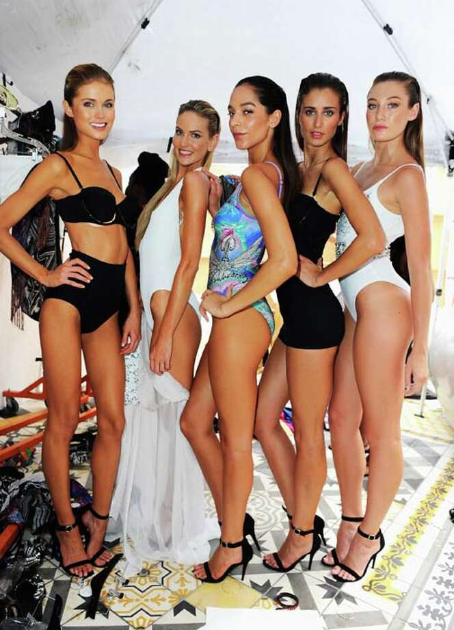 MIAMI, FL - JULY 21:  Models pose at the Gottex show during Mercedes-Benz Fashion Week Swim 2014 at the SLS Hotel on July 21, 2013 in Miami, Florida. Photo: Serg Alexander, Getty Images For Mercedes-Benz Fashion Week Swim 2014 / 2013 Getty Images