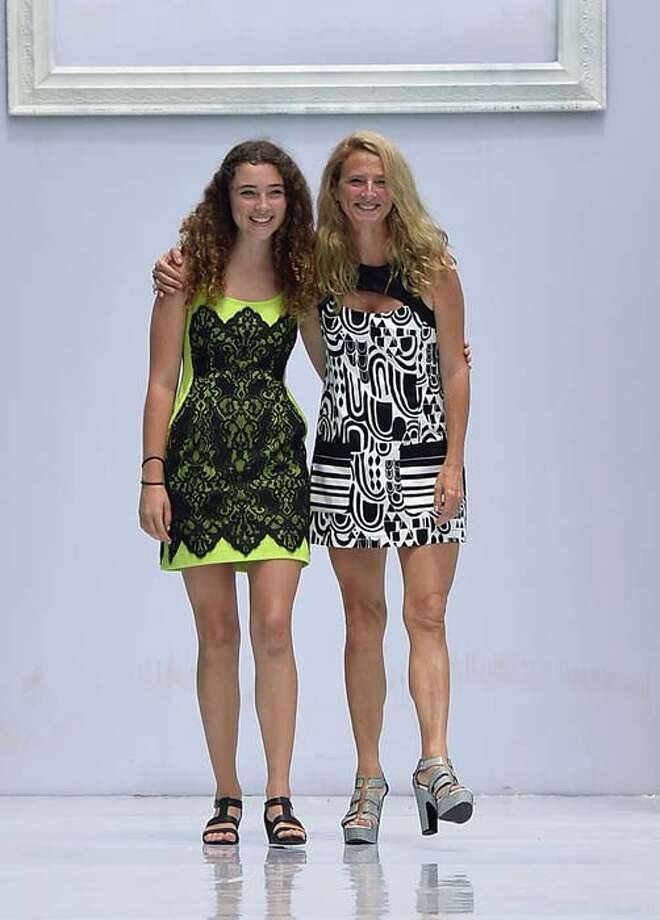 MIAMI, FL - JULY 21: Designer Nanette Lepore (R) and Violet Lepore pose on the runway during the Nanette Lepore Swim Press Preview during Mercedes-Benz Fashion Week Swim 2014 at the SLS Hotel on July 21, 2013 in Miami, Florida. Photo: Mike Coppola, Getty Images For Mercedes-Benz Fashion Week Swim 2014 / 2013 Getty Images