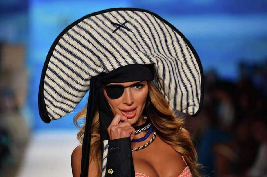 MIAMI, FL - JULY 21:  A model walks the runway at the Maaji Swimwear show during Mercedes-Benz Fashion Week Swim 2014 at Cabana Grande at the Raleigh on July 21, 2013 in Miami, Florida. Photo: Frazer Harrison, Getty Images For Maaji Swimwear / 2013 Getty Images