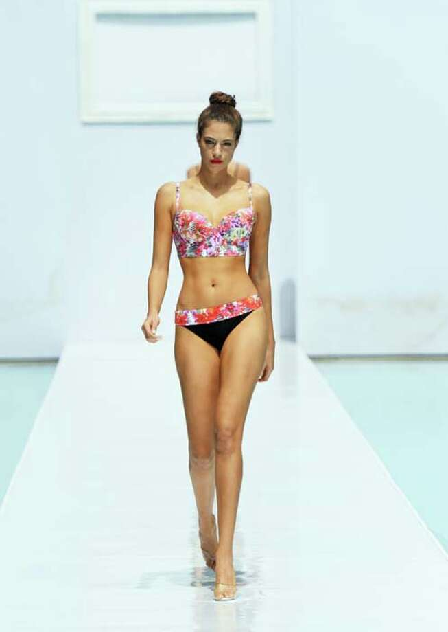 MIAMI, FL - JULY 21:  A model walks the runway at the Gottex show during Mercedes-Benz Fashion Week Swim 2014 at the SLS Hotel on July 21, 2013 in Miami, Florida. Photo: Mike Coppola, Getty Images For Mercedes-Benz Fashion Week Swim 2014 / 2013 Getty Images