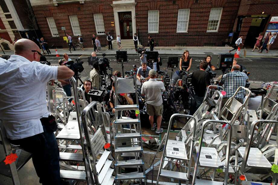 Members of the media gather across St. Mary's Hospital exclusive Lindo Wing in London, Monday, July 22, 2013. Buckingham Palace officials say Prince William's wife, Kate, has been admitted to the hospital in the early stages of labour. Royal officials said that Kate traveled by car to St. Mary's Hospital in central London. Kate _ also known as the Duchess of Cambridge _ is expected to give birth in the private Lindo Wing of the hospital, where Princess Diana gave birth to William and his younger brother, Prince Harry.The baby will be third in line for the British throne _ behind Prince Charles and William _ and is anticipated eventually to become king or queen. Photo: Lefteris Pitarakis