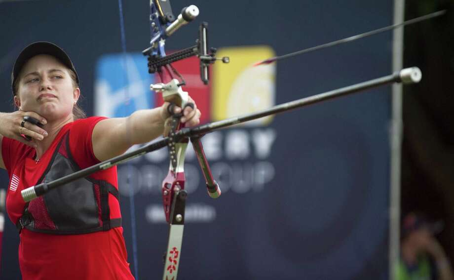US Miranda Leek shoots an arrow during the Archery World Cup recurve women individual final competition against Inna Stepanova of Russia in Medellin, Antioquia department, Colombia on July 21, 2013. Leek won the silver medal. AFP PHOTO/Raul ARBOLEDARAUL ARBOLEDA/AFP/Getty Images Photo: RAUL ARBOLEDA, AFP/Getty Images / AFP