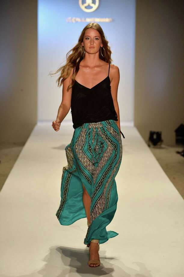 A model walks the runway at the ViX Paula Hermanny show during Mercedes-Benz Fashion Week Swim 2014 at the Raleigh on July 20, 2013 in Miami Beach, Florida. Photo: Frazer Harrison, Getty Images For Mercedes-Benz / 2013 Getty Images