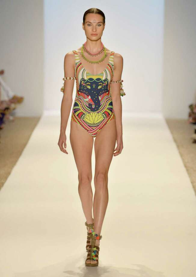 A model walks the runway at the Mara Hoffman Swim show during Mercedes-Benz Fashion Week Swim 2014 at the Raleigh on July 20, 2013 in Miami Beach, Florida. Photo: Frazer Harrison, Getty Images For Mercedes-Benz / 2013 Getty Images