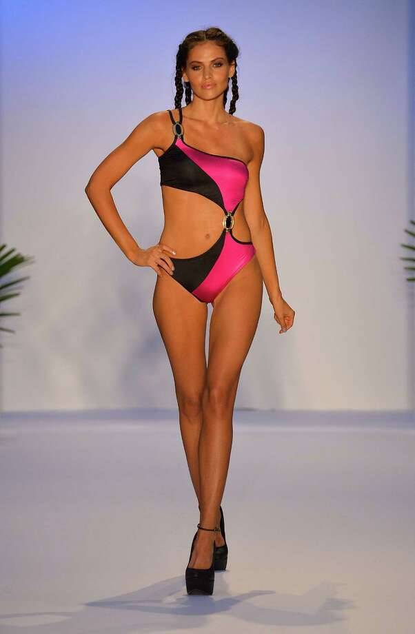 A model walks the runway at the Aqua Di Lara show during Mercedes-Benz Fashion Week Swim 2014 at the Raleigh on July 20, 2013 in Miami Beach, Florida. Photo: Frazer Harrison, Getty Images For Mercedes-Benz / 2013 Getty Images