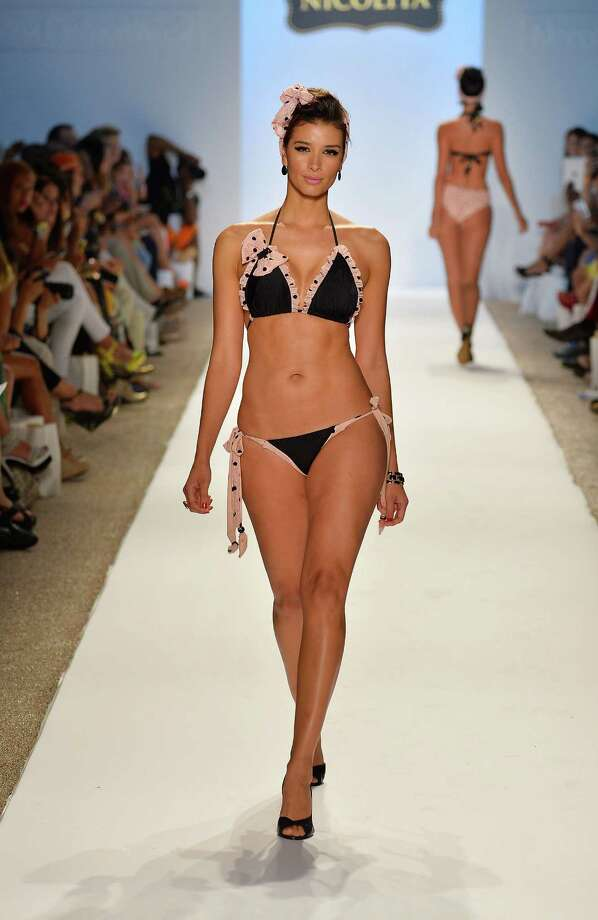 A model walks the runway at the Nicolita show during Mercedes-Benz Fashion Week Swim 2014 at the Raleigh on July 20, 2013 in Miami Beach, Florida. Photo: Frazer Harrison, Getty Images For Mercedes-Benz / 2013 Getty Images