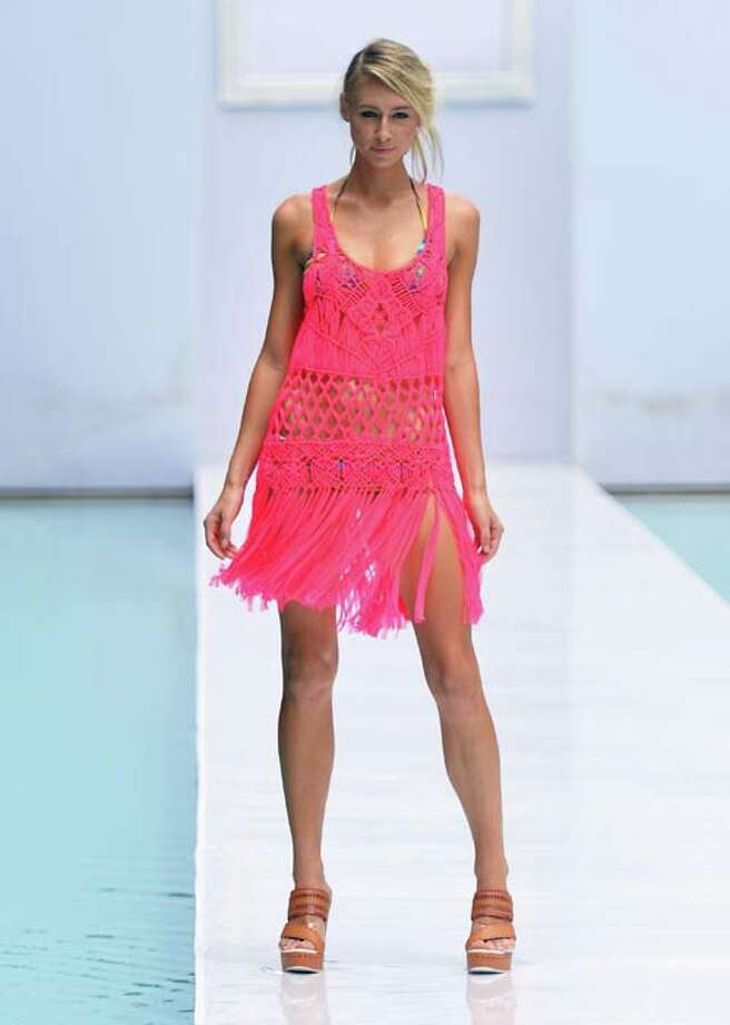 A model walks the runway during the Nanette Lepore Swim Press Preview during Mercedes-Benz Fashion Week Swim 2014 at the SLS Hotel on July 21, 2013 in Miami, Florida. Photo: Mike Coppola, Getty Images For Mercedes-Benz Fashion Week Swim 2014 / 2013 Getty Images