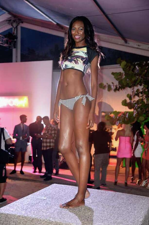 A model poses at the Roxy Presentation during the Mercedes-Benz Fashion Week Swim 2014 Official Kick Off Party at the Raleigh Hotel on July 18, 2013 in Miami Beach, Florida. Photo: Frazer Harrison, Getty Images For Mercedes-Benz Fashion Week 2014 / 2013 Getty Images