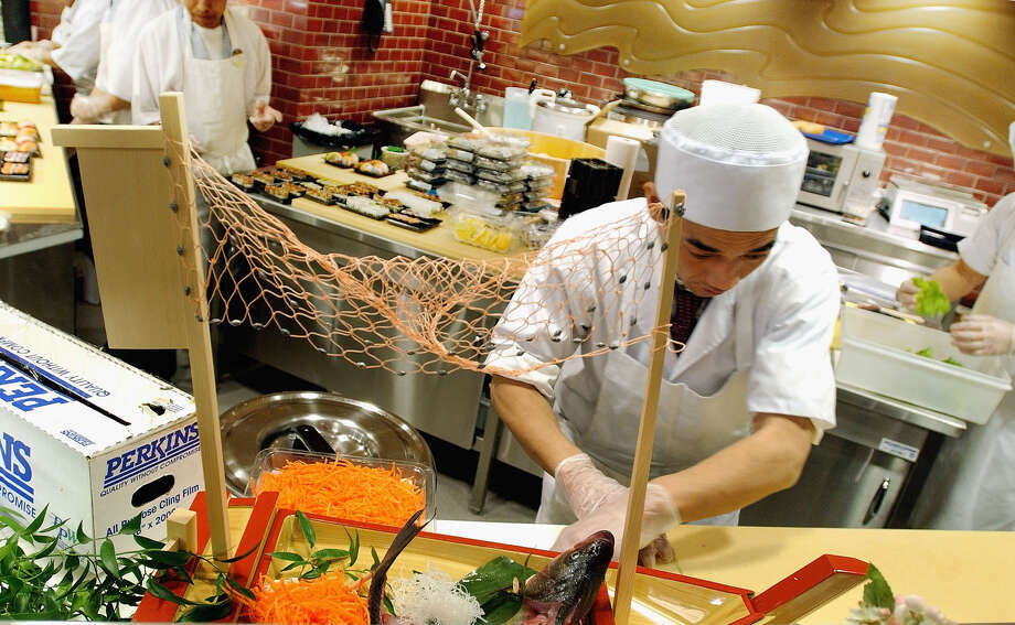 NEW YORK - FEBRUARY 5:  A sushi chef prepares food as Whole Foods Market readies for its opening February 5, 2004 in New York City.  The market, located at the newly opened Time Warner Center is 59,000 square feet and becomes the largest supermarket in the Manhattan borough of New York. Photo: Stephen Chernin, Getty Images / 2004 Getty Images