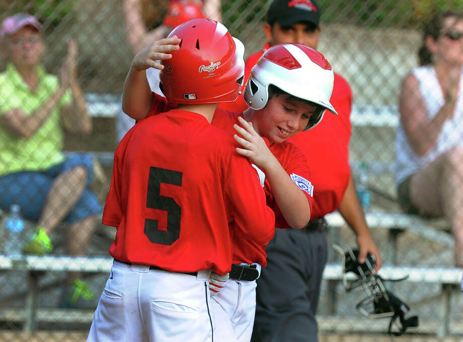 Fairfield American's Jack Steed, teammate Brian Kiremidjian, and the rest of the Fairfield American 11-year-old Little League team are just one win from the state championship series. Photo: Christian Abraham / Connecticut Post