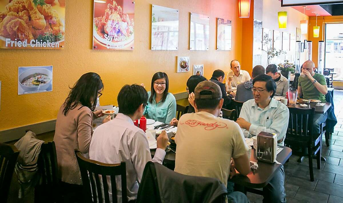 People enjoy lunch at GangNam Chicken in San Mateo, Calif., on Thursday, July 18th, 2013.