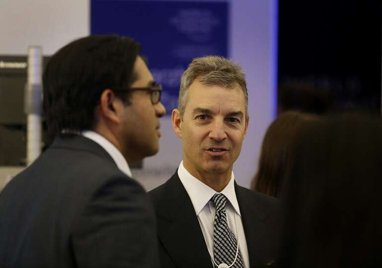Daniel Loeb, chief executive officer of Third Point LLC, center, speaks with fellow attendees betwee