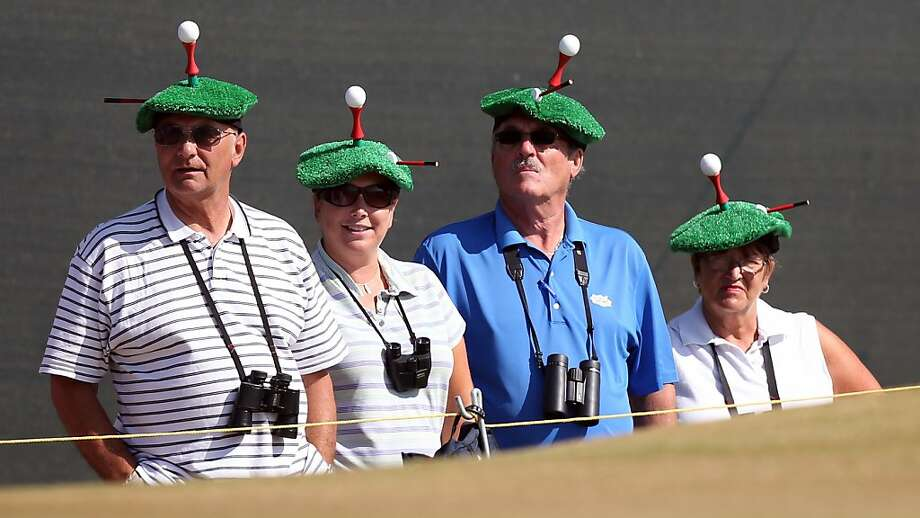 The ball lads (and lasses) of the greens berets: Golf-loving couples watch the action at the British Open at Muirfield in Gullane, Scotland. Photo: Adrian Dennis, AFP/Getty Images