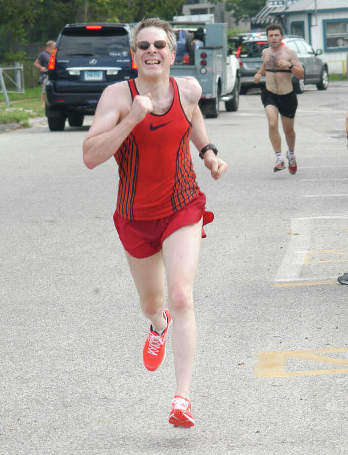 Paul Greenberg, 52, of Westport, races to a ninth-place finish in 26:02 in the Westport Road Runners 4.1 mile race on Saturday at Compo Beach in Westport. Photo: Contributed Photo