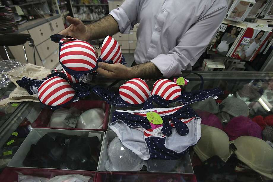 Banner the bra:In Iran, which is hardly pro-United States these days, it's possible to buy star-spangled lingerie. Made in China, naturally. (Old main bazaar, Tehran.) Photo: Vahid Salemi, Associated Press