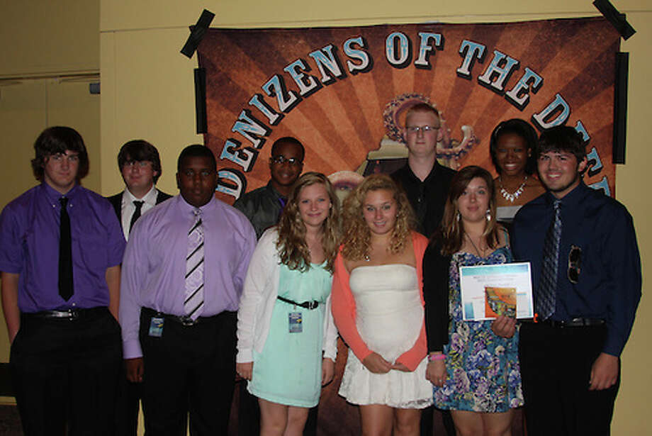 Joseph Townsend, Tyler Townsend (mentor), Jeremiah Miller, Joshua Benton, Brooke Welch, Amanda Edwards, Andrew Kain, Alyssa Murrell, NayJeah Pridgen and Sean Russell. Photo: Provided By The Houston Independent School District