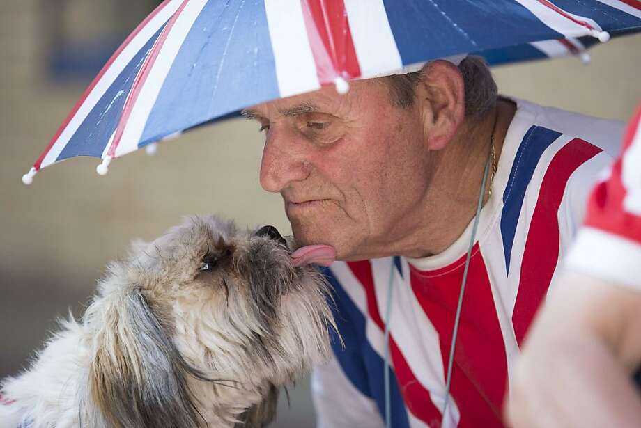 The ordeal is finally over for the birth groupies:A loving kiss from Benji helps Terry Hutt endure the long hours standing outside St. Mary's Hospital in London waiting for Kate Middleton to have the royal baby. After a long labor, the duchess of Cambridge gave birth to a son Monday afternoon. You can finally relax, sir! Photo: Justin Tallis, AFP/Getty Images