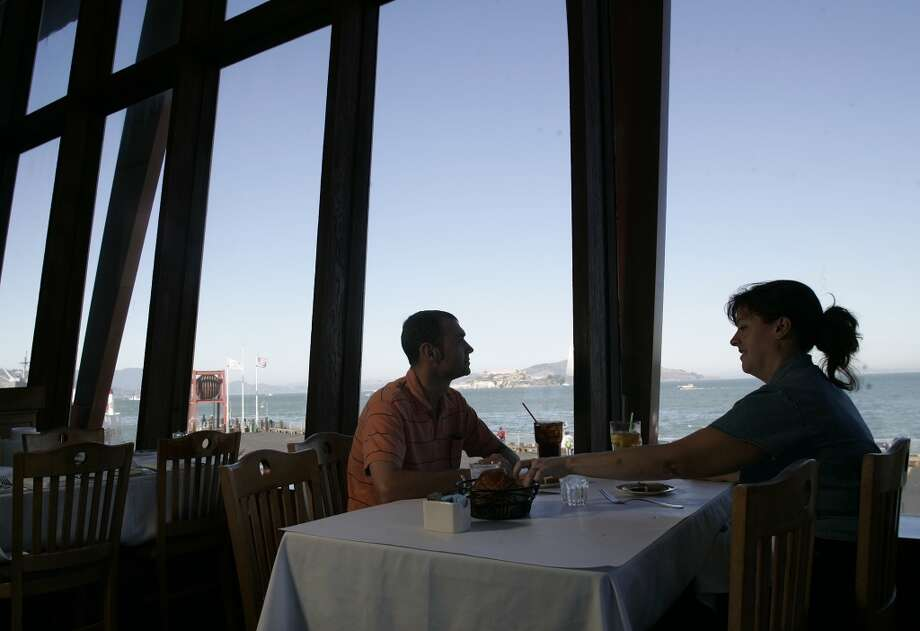 Tony and Stephanie Cracknell, visiting from London, England,  enjoy lunch and the view of San Francisco Bay. 2005.