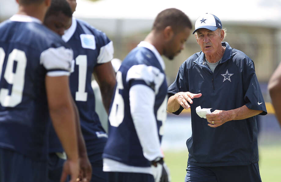 Defensive coordinator Monte Kiffin (center) oversees morning practice at the 2013 Dallas Cowboys training camp on Monday, July 22, 2013 in Oxnard. Photo: Kin Man Hui, San Antonio Express-News / ©2013 San Antonio Express-News