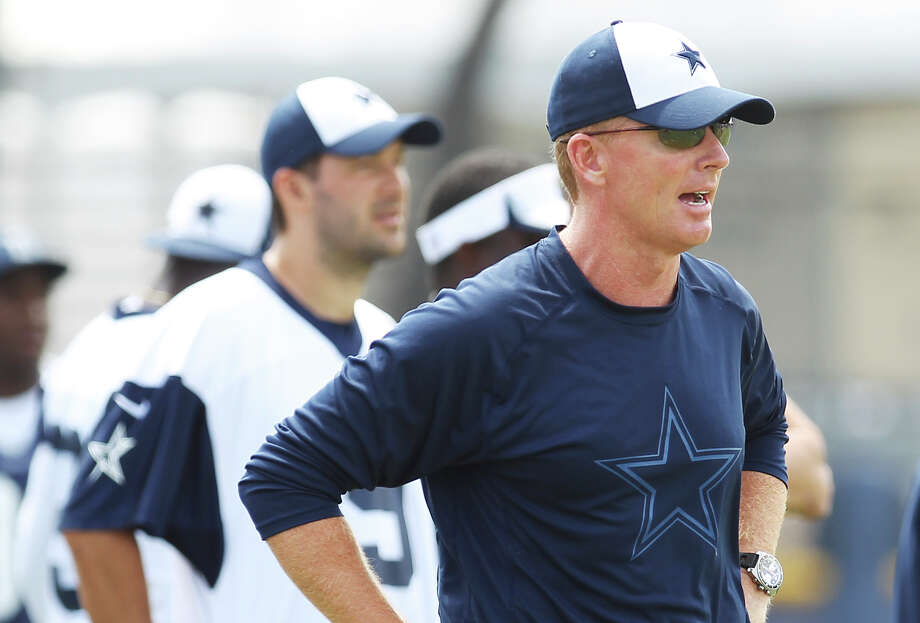 Head coach Jason Garrett keeps a close eye on morning practice at the 2013 Dallas Cowboys training camp on Monday, July 22, 2013 in Oxnard. Photo: Kin Man Hui, San Antonio Express-News / ©2013 San Antonio Express-News