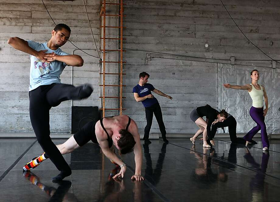 """Dancers James Gilmer (left) and Weston Krukow (bending) rehearse for choreographer Marc Brew's piece at Zaccho Dance Theater in San Francisco, Calif., on Friday, July 19, 2013.  Amy Seiwert's Imagery presenting """"Sketch 3: Expectations,""""  includes world premieres by  Marc Brew. Photo: Liz Hafalia, The Chronicle"""