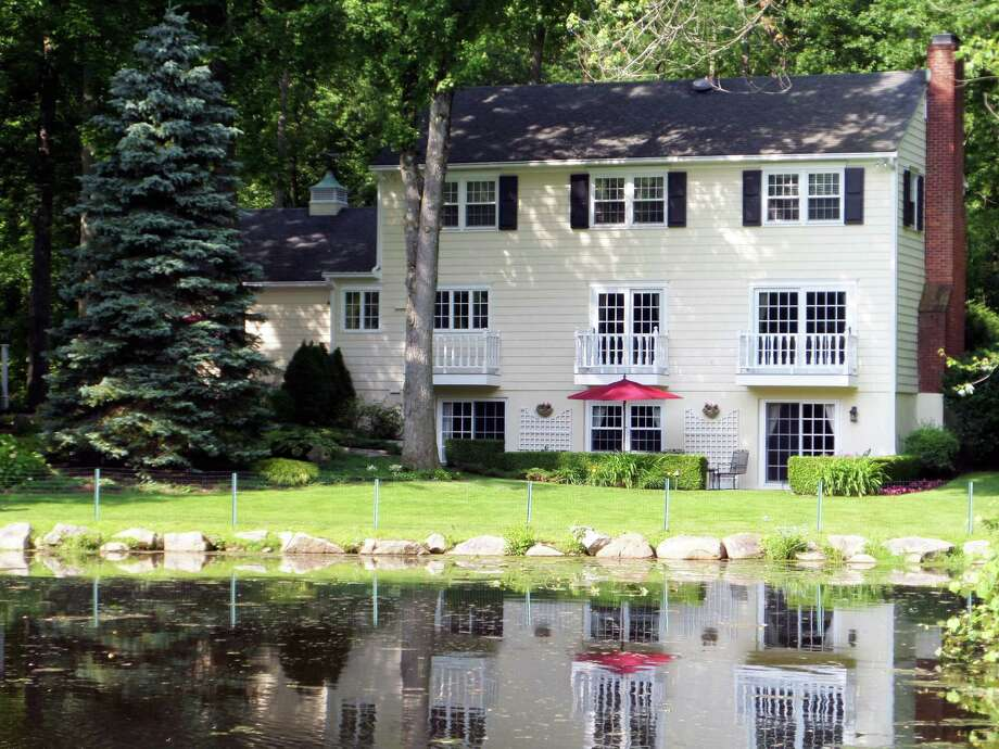 The house at 5 Blind Brook Road South, on the market for $1.595 million, fronts on Nash Pond. Photo: Contributed Photo / Westport News contributed