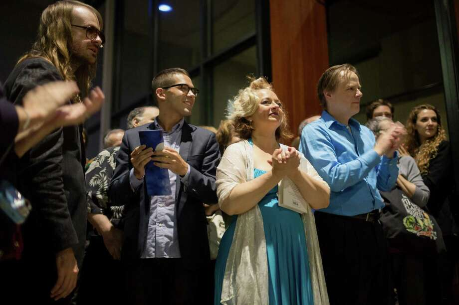 Breedlove, left, music composer, Bobbi Kotula, center, lead actress playing Victoria Sage, and Mark Anders, center right, lead actor playing Stu Rasmussen, listen to a speech at the afterparty for the Stu For Silverton production Saturday, July 20, 2013, outside of the Intiman Theatre in Seattle. Photo: JORDAN STEAD, SEATTLEPI.COM / SEATTLEPI.COM
