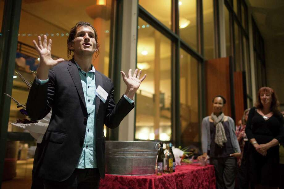 Andrew Russell, producing artistic director at the Intiman Theatre, addresses a crowd during the afterparty for the Stu For Silverton production Saturday, July 20, 2013, outside of the Intiman Theatre in Seattle. Photo: JORDAN STEAD, SEATTLEPI.COM / SEATTLEPI.COM