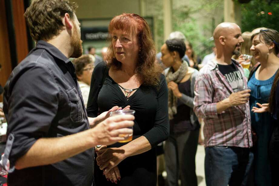 Attendees gather at the afterparty for the Stu For Silverton production Saturday, July 20, 2013, outside of the Intiman Theatre in Seattle. Photo: JORDAN STEAD, SEATTLEPI.COM / SEATTLEPI.COM