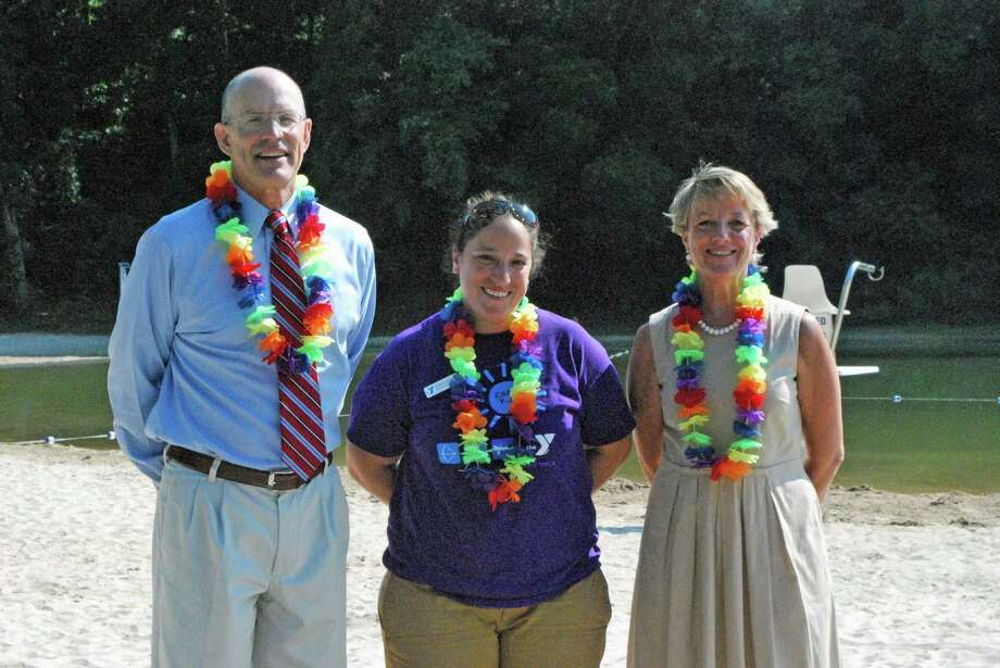 The New Canaan YMCA will host a family luau on Friday, Aug. 9, at Kiwanis Park from 6 to 8 p.m. Above, from left, Craig Panzano, executive director, New Canaan YMCA; Davie Cedela, youth & family director New Canaan YMCA; and Gail Donovan, branch manager, Bank of New Canaan. Photo: Contributed Photo