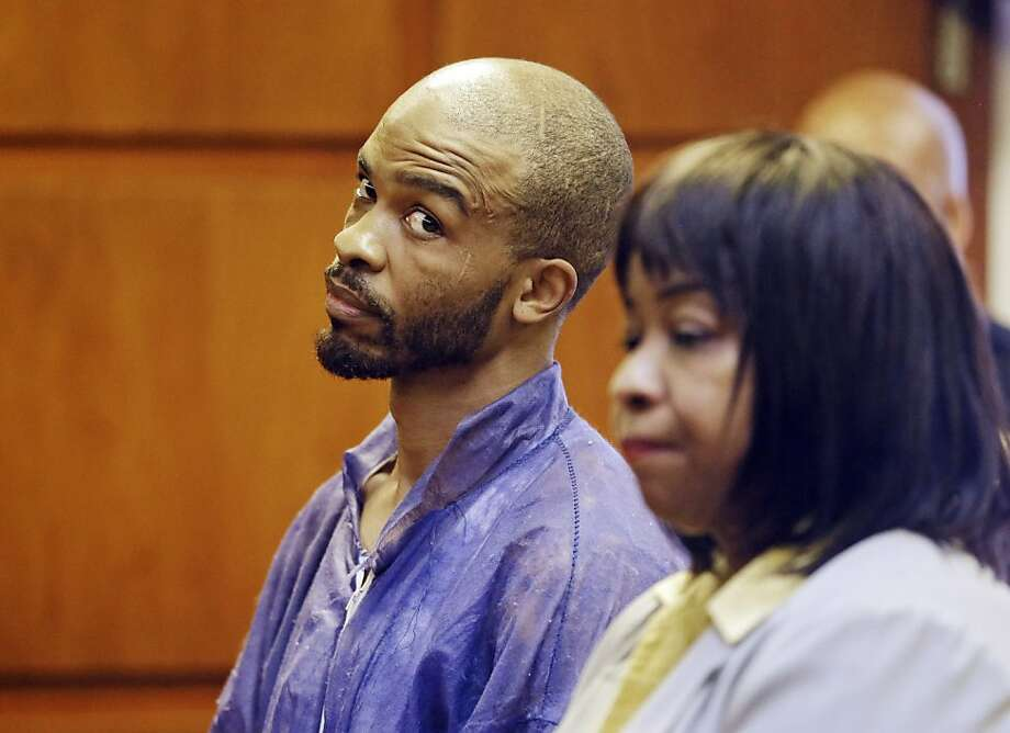 Michael Madison glances at court-appointed attorney Marlene Rideenour as he is arraigned in the deaths of three women found in garbage bags. Photo: Mark Duncan, Associated Press