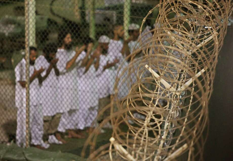 Detainees pray at the Guantanamo Bay detention facility in 2009. A judge recently barred invasive searches of detainees. Photo: Associated Press File Photo