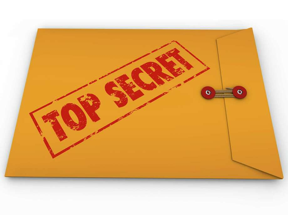 A yellow envelope with a red stamp with the words Top Secret conveying that the information inside is a secret, private, confidential, restricted message Photo: IQoncept / iQoncept - Fotolia