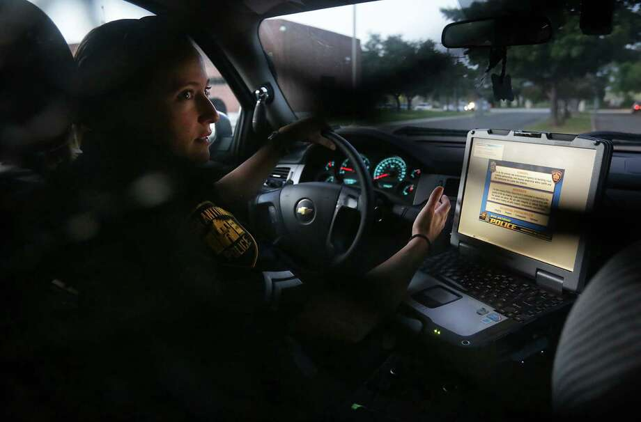 San Antonio Police Detective Stephanie Landry starts on her South Side patrol early shift, Wednesday, July 10, 2013. Photo: Bob Owen, San Antonio Express-News / © 2012 San Antonio Express-News
