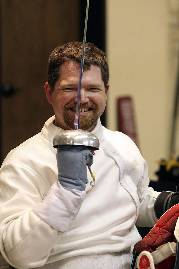 Curt Oswalt takes a break from practice for wheelchair fencing competition. Photo: Tom Reel / San Antonio Express-News