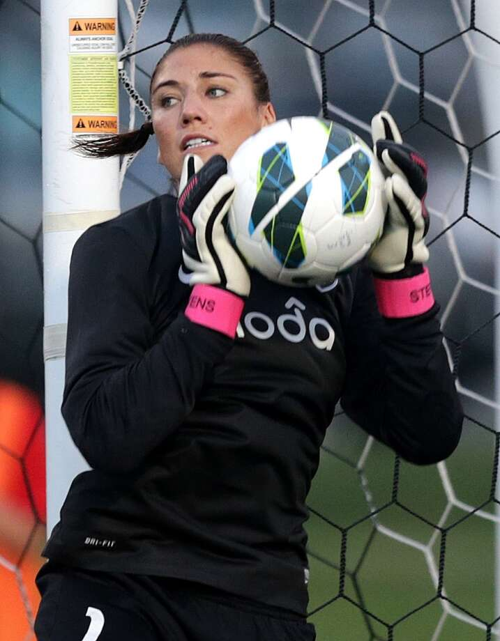 Seattle Reign goalkeeper Hope Solo in action during a game against the Boston Breakers at Dilboy Stadium in Somerville. Photo: Barry Chin, Boston Globe / Getty Images