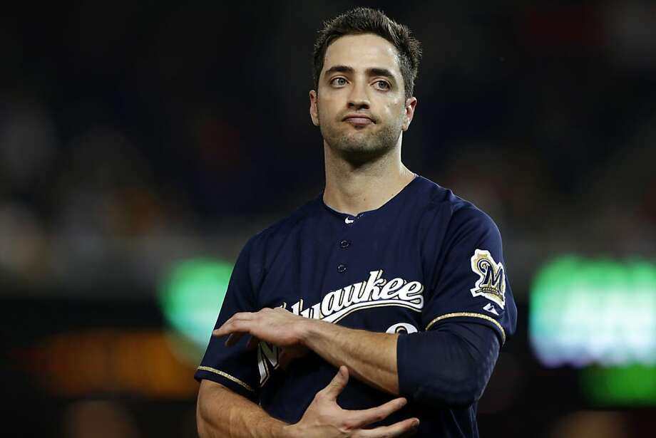 FILE - In this Sept. 21, 2012, file photo, Milwaukee Brewers Ryan Braun reacts while holding his elbow after missing his swing during a baseball game against the Washington Nationals at Nationals Park in Washington. Braun says he used the person who ran the Florida clinic now under investigation by Major League Baseball as a consultant on his drug suspension appeal last year and nothing more.  Yahoo Sports reported Tuesday, Feb. 5, 2012, that his name showed up three times in records of the Biogenesis of America LLC clinic.  (AP Photo/Jacquelyn Martin, FIle) Photo: Jacquelyn Martin, Associated Press